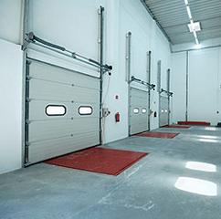 2 commercial garage doors we installed in little rock, ar