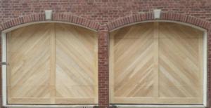 custom wood garage doors on a brick home in north little rock, arkansas